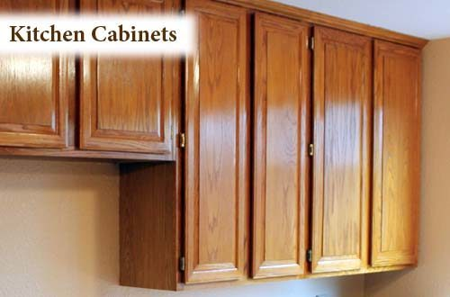 Multi-level oak kitchen cabinets, with natural finish