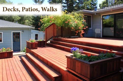 Spacious multi-level redwood deck with flower planters