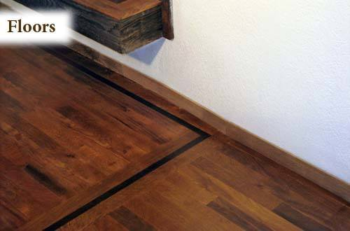 Natural finish hardwood floor  with black oak trim